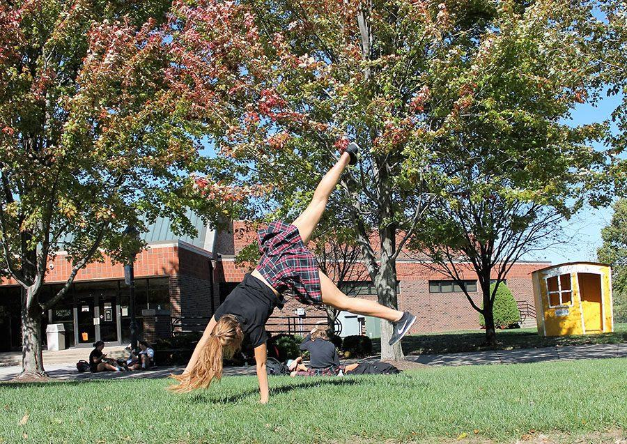 Junior Lulu Fiss cartwheels in the quad at STA Oct. 17. photo by Meghan Baker