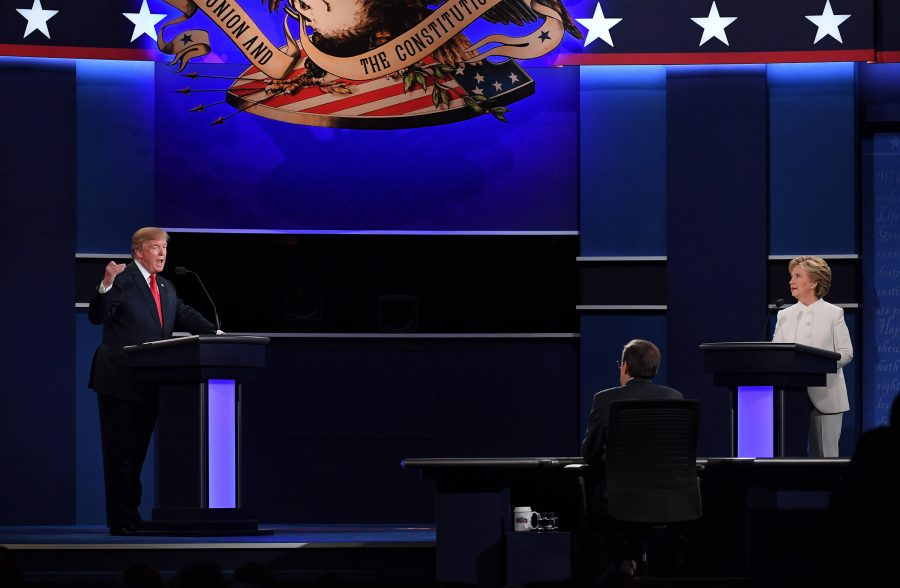 Republican presidential candidate Donald Trump, left, and Democratic presidential candidate Hillary Clinton, right, stand on stage at the third and final presidential debate in Las Vegas, Nevada. photo courtesy of Tribune News Service