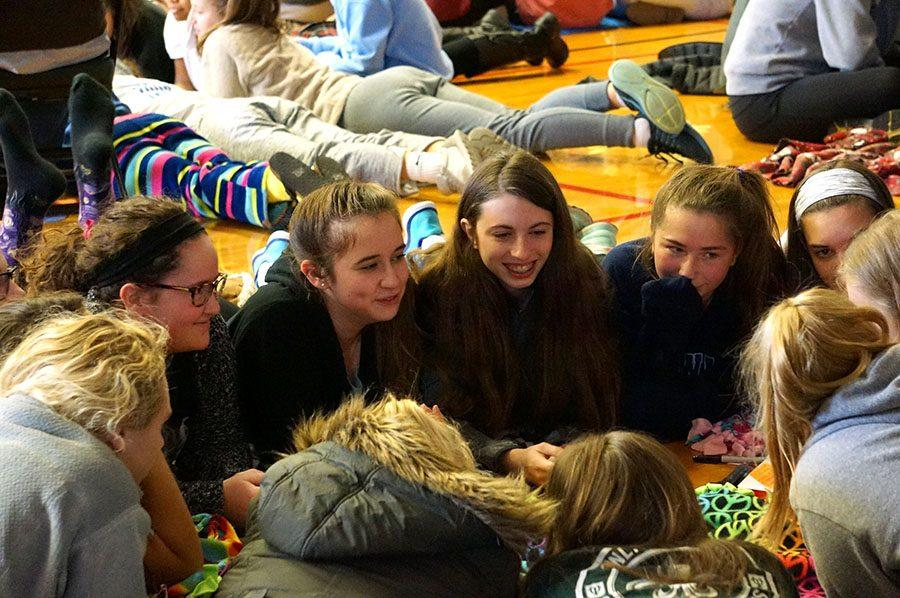 Junior Emilie Blanck, left, and freshmen Murphy O'Dell, Abby Growney and Olivia Grego listen while a fellow advisee speaks. Members of the Lewis advisory, the girls bonded while playing the