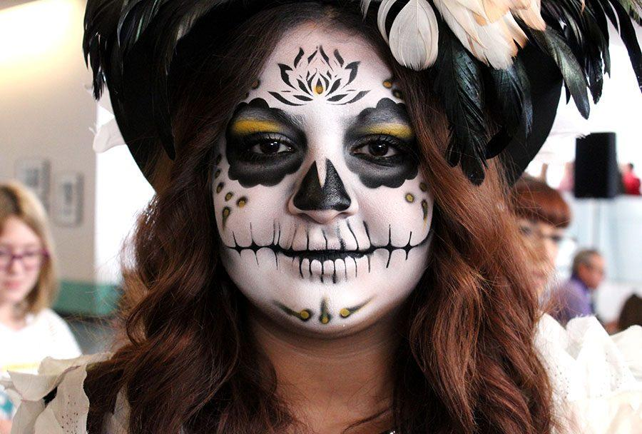 A Dia de los Muertos attendant modeled to show off her skull makeup on her face at the Nelson Atkins Museum Nov 6.The Nelson holds the event annually to honorthose who have passed away. photo by Meggie Mayer