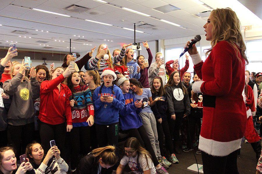 STA freshmen and sophmores sing along with senior Makenzie O'Guinn as she performs for the senior fundraiser Dec 1. O'Guinn sang two of her hit songs,