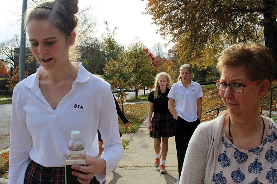 Junior Catherine Ebbitts, left, talks to physics teacher Terry Conner while walking to Loose Park Nov. 17. The walk was led by Conner and occurred activity period 1. photo by Anna Louise Sih