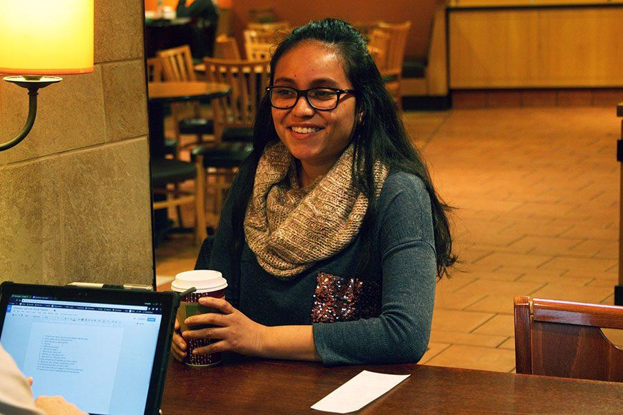 Former Spanish teacher Marina Lopez sits during an interview held Nov. 27 at the Panera located on the Country Club Plaza. Lopez left STA in 2016, but is currently teaching Spanish at Northeast High School in northeastern Kansas City. photo by Cassie Hayes