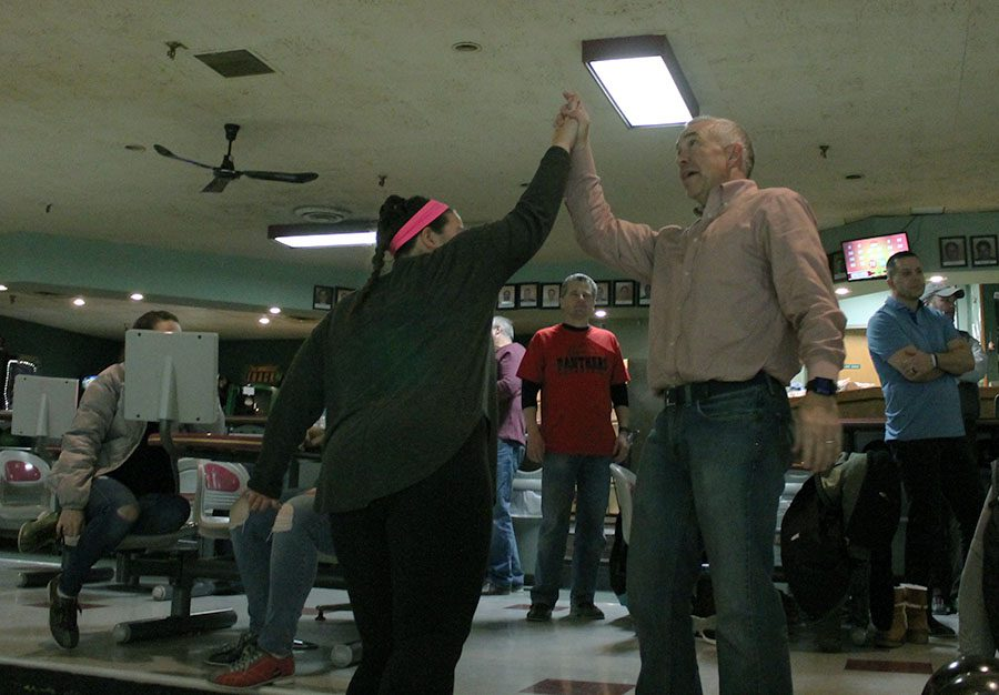 Junior+Sloane+Smith+and+her+father+Gary+Smith+high-five+at+Ward+Parkway+Lanes+Jan.+8.+photo+by+Meghan+Baker