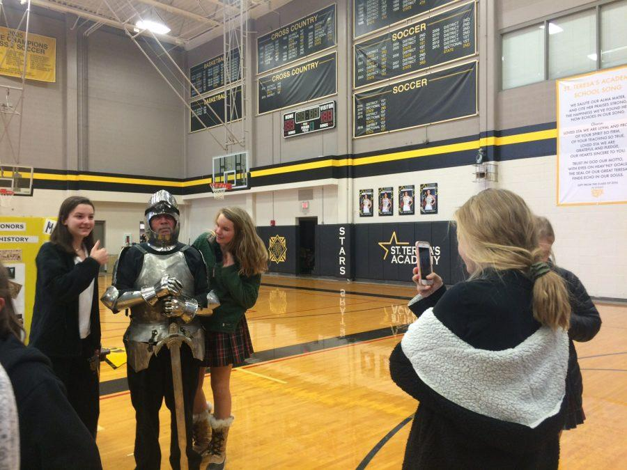 Freshmen+Anna+Johnson+and+Abby+Schipfer+pose+for+a+photo+with+European+History+teacher+Mike+Egner.+Egner+dressed+in+Medeival+armor+to+promote+his+European+History+class.+photo+by+Julia+Kerrigan