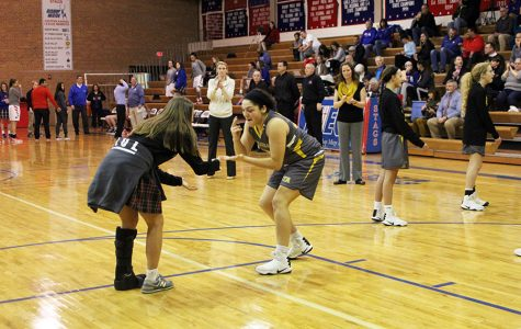 Sophomore Lily Farkas, left, and sophomore Hailey Coleman, right, perform their handshake during the pre-game walk out. The STA Stars took on the Miege Stags Tuesday January 17, 2016.
