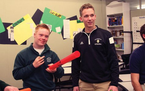Archbishop O'Hara freshman Pete Whittaker, FIRE student, and senior Ryan Rieger prepare to perform a song with boomwhackers. Rieger assists students in a variety of ways at O'Hara, his main job being assisting FIRE students in learning to drive using golf carts. photo by Cassie Hayes