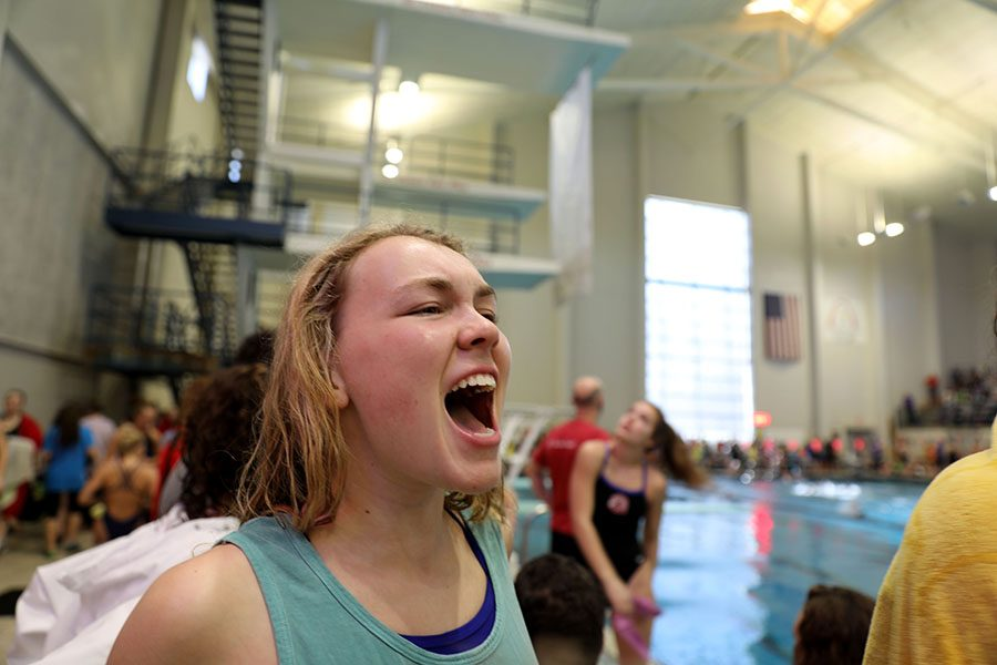 Sophomore+Caroline+Penner+yells+for+her+teammate+Libby+Hutchinson+while+she+swims+the+200+freestyle.+Penner+joined+the+starfish+this+year+and+qualified+for+state+in+the+200+and+400+freestyle+relays.+photo+by+Gabby+Ayala