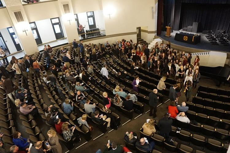 Audience and inductees gather in the auditorium for the National Honor Society Ceremony Feb. 7. photo by Catherine Ebbitts