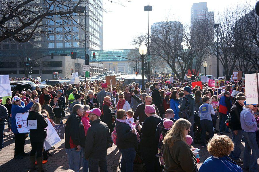 A crowd of protesters gathers in front of the entrance to Washington Square Park during the Women's March. The sister march to the Women's March on Washington was held Jan. 21 in Kansas City and was said to have had an attendance of 10,000 people. photo by Gabby Martinez