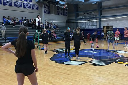STA juniors wait for the volleyball to be served during a charity volleyball game at Rockhurst High School. The stars came in third place. photo courtesy of Megan Cotter