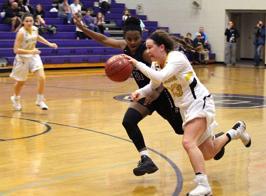 STA+senior+Olivia+Woodbury+dribbles+past+a+Park+Hill+South+player+at+the+district+basketball+game+Feb+28.+Woodbury+has+competed+for+the+Stars+for+four+years.+photo+courtesy+of+Jami+Woodbury