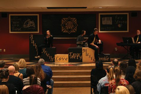 Senior Rose Genaris and Rockhurst High School senior Oliver Hutchison perform a song at the Karlin Kabaret in the Commons Mar. 7. This year's theme was