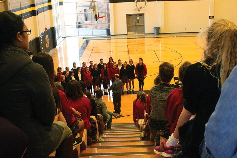 The STA choir sings to commence the Mother Evelyn O'Neill ceremony March 7. photo by Cassie Hayes