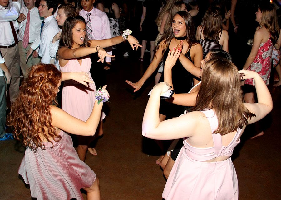 Juniors Hannah Steen, from left, Julia Mantel and Mia Schloegel dance together at the Junior Ring dance Apr. 8. The dance took place in the Commons. photo by Paige Powell