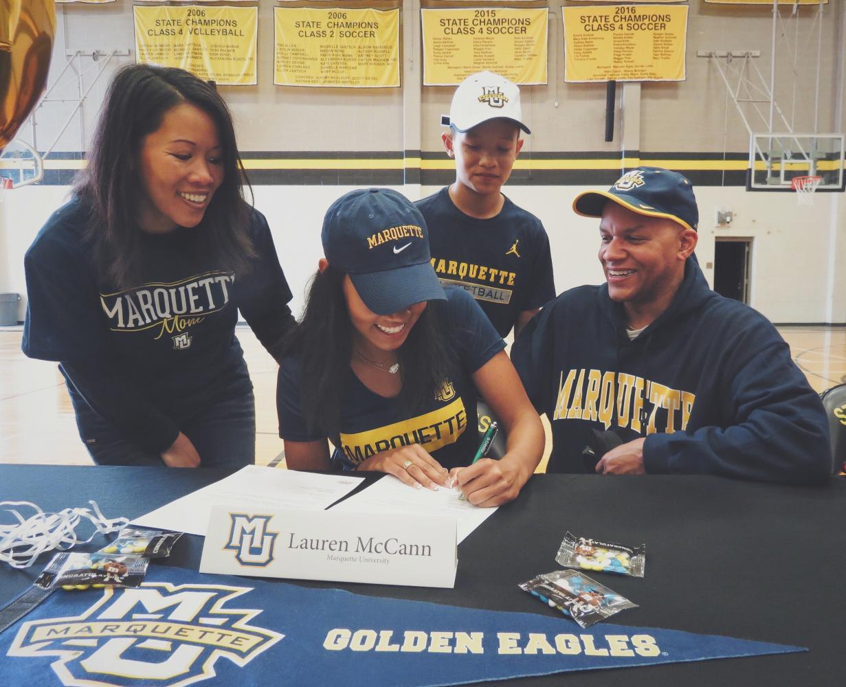 Senior Lauren McCann surounded by her family as she signs to Marquette University. Photo courtesy of Lauren McCann