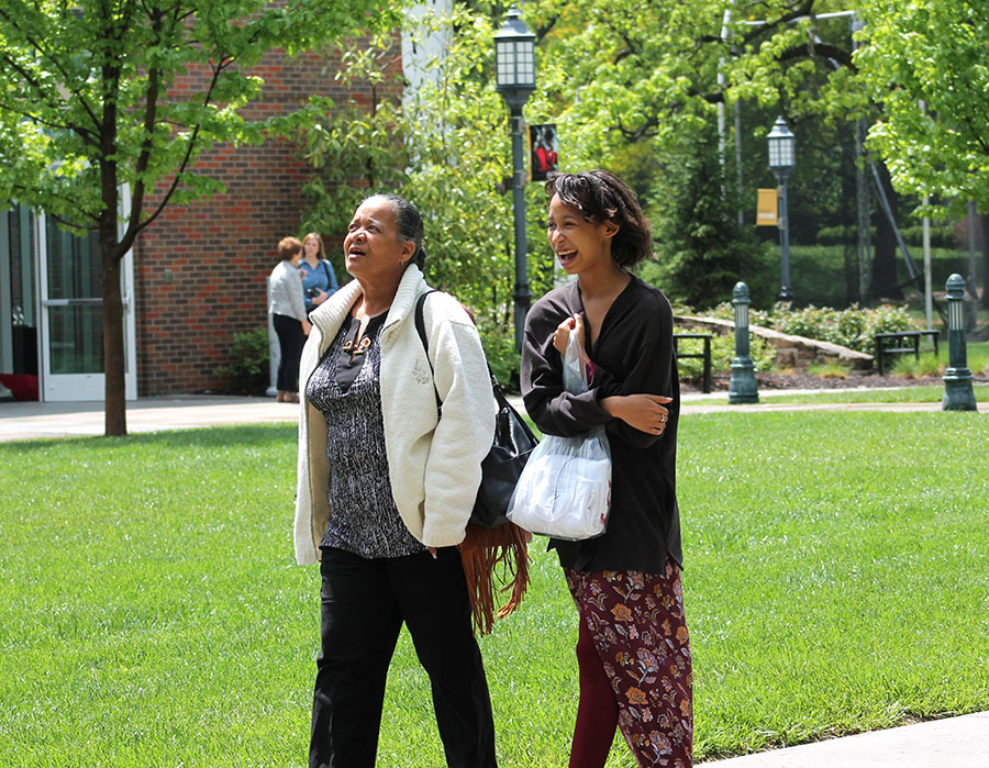Freshman Christian Lunn laughs as she walks through the quad with her grandmother, Lorraine Johnson, during Grandparents Day at St. Teresa's Academy April 30. photo by Meghan Baker