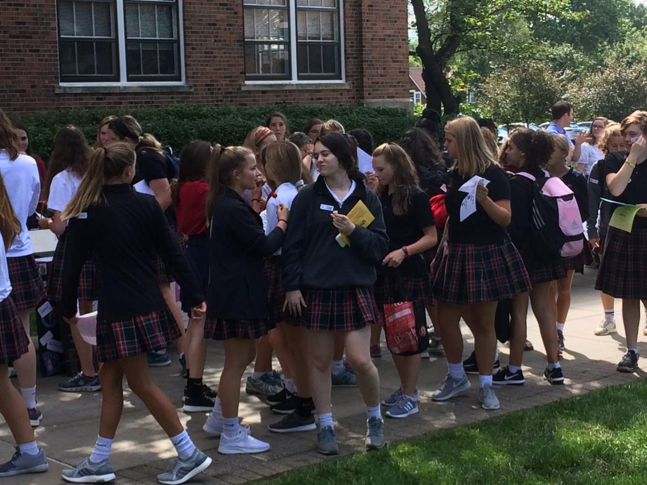Students+walked+from+table+to+table+outside+of+Donnelly+Hall%2C+where+extracurricular+sign+ups+were+located.+photo+by+Gabby+Staker