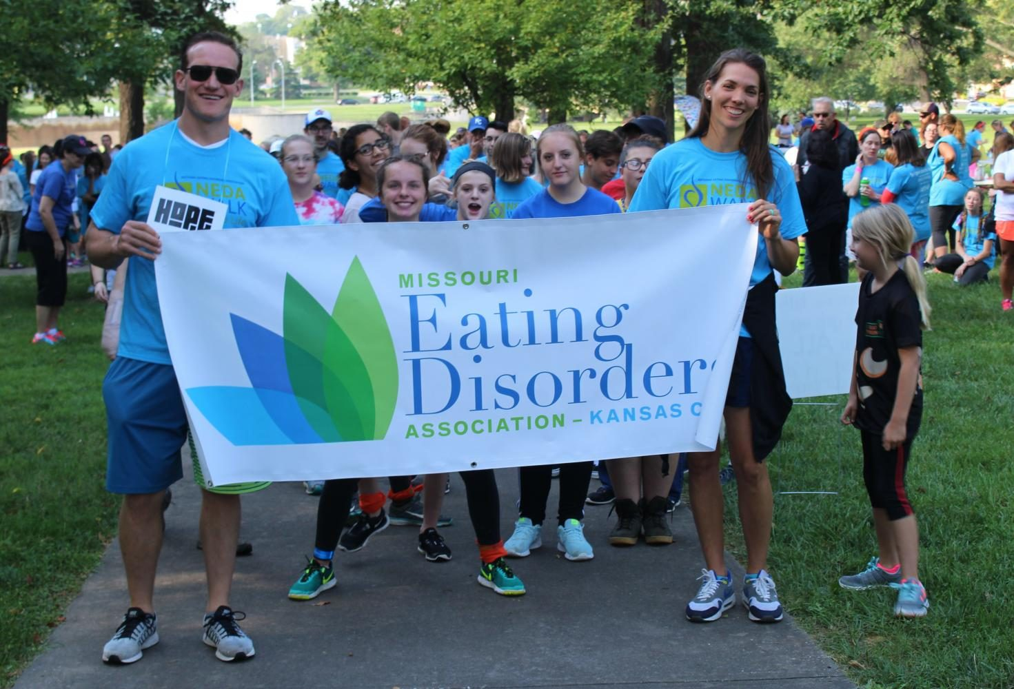 Two of the speakers at the walk hold a NEDA sign and pose for a picture right before walking Aug. 26. Both of the speakers spoke about their struggles with eating disorders. photo by Madeline Loehr