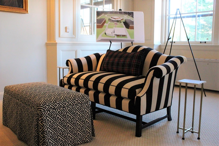 A diagram of the STA campus stands behind a new love seat with tartan plaid throw pillow in Zahner Lounge Aug. 24. photo by Madeline Loehr