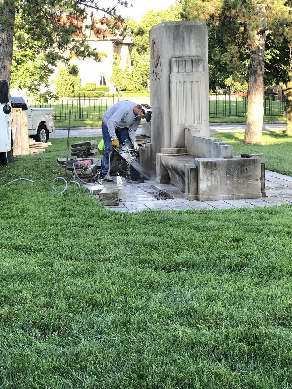 A worker begins to take down the monument on Ward Parkway. photo by Margaux Renee