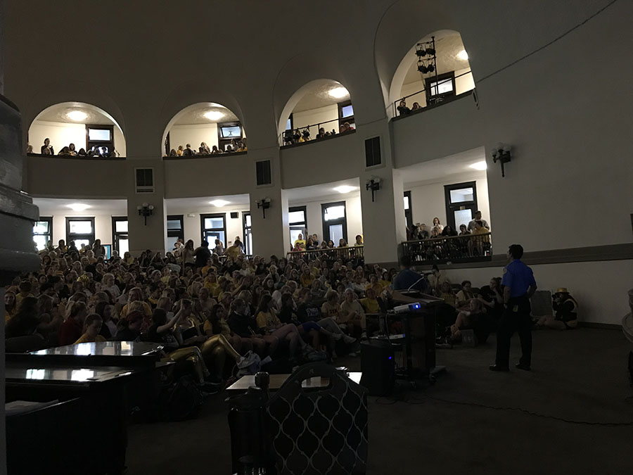 Students raise their hands to ask DiMartino questions on drinking and drug abuse laws Sept. 22. photo by Trang Nguyen