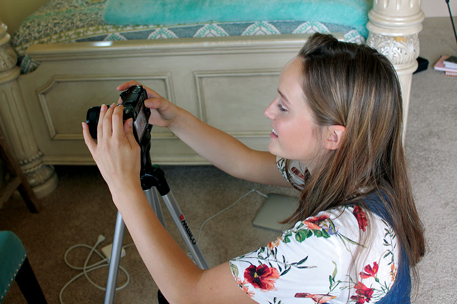 Former St. Teresa's Academy Student, Tatum Starr sets up camera to film a  youtube video Sep. 4. Starr's youtube username is TatumTube and she posts new videos every wednesday. photo by Kate Jones