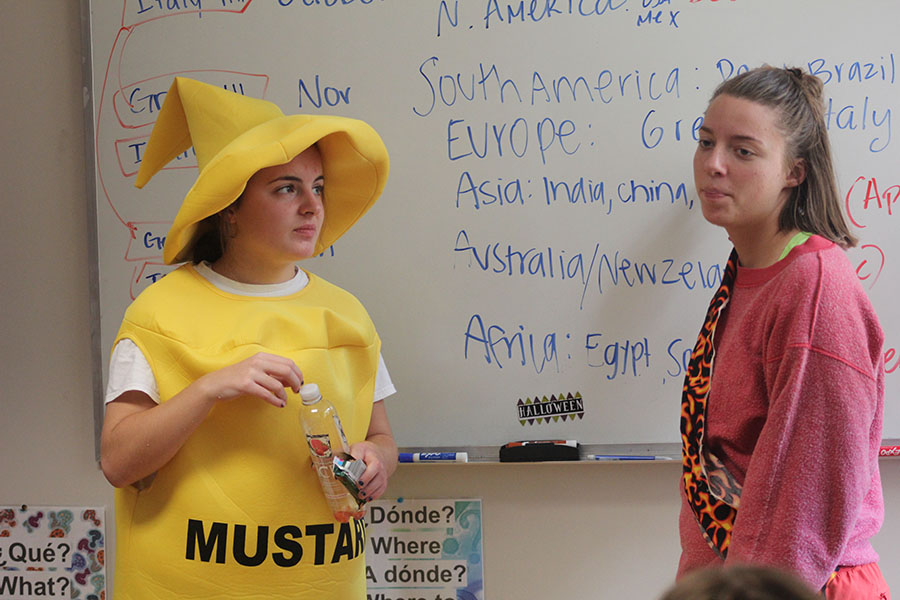 Seniors Kathleen Graham and Grace Oest talk to World Cultures Club participants Sept. 29. Graham is President and Oest is Vice-President. photo by Riley McNett