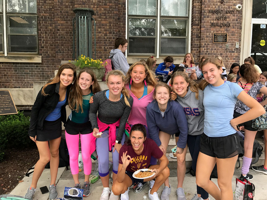 From left to right juniors Isabel Thornton, Caroline Armstrong, Caroline Penner, Grace Boers, Kate Coppinger, Camille Begnaud, Caroline Stuckey and Olivia Wirtz on workout day, Sept. 20. photo by Ella Norton