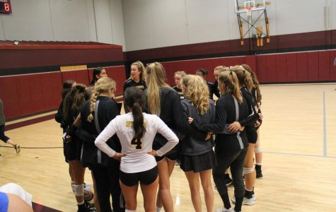 The Stars huddled up during a timeout in the game against Lees Summit High School. photo by Ella Norton.