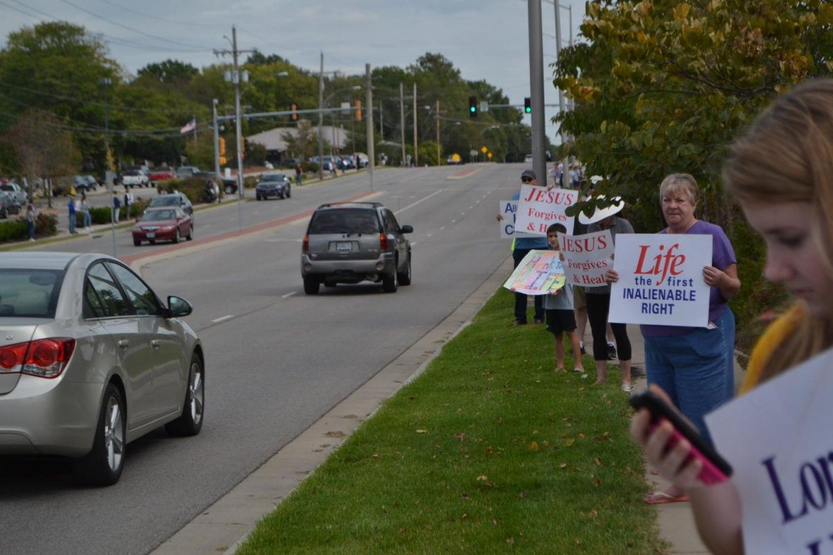 People lined the street holding signs to spread pro-life awareness. photo by Delaney Hupke