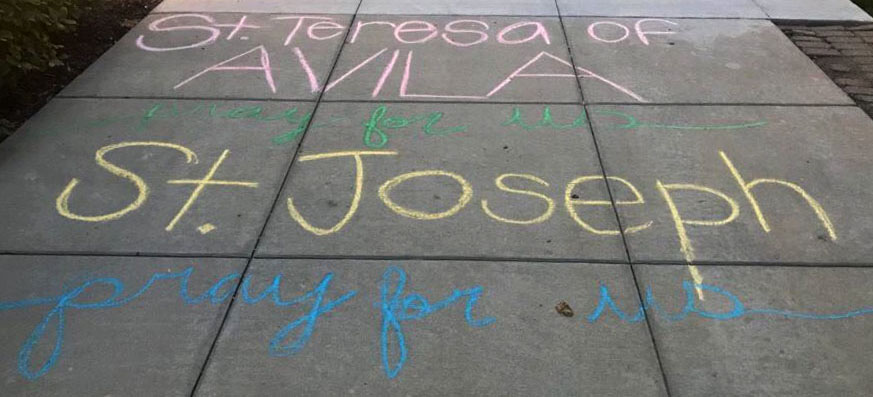 Several seniors drew uplifting chalk drawings on campus, with the goal of spreading positivity. photo by Kate Jones