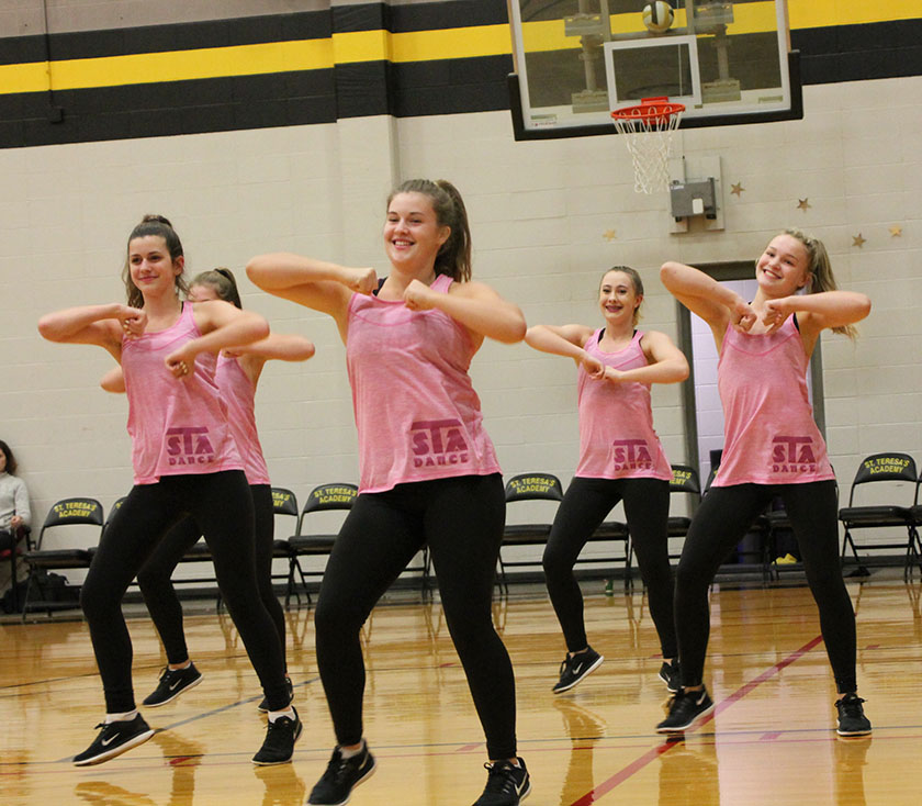 Dance team members perform before the varsity game starts at St. Teresa's Academy Oct. 4. photo by Meghan Baker