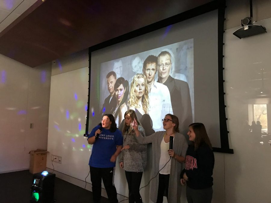 Seniors, Sloane Smith, Siobhan Bradley, Devin John, and Gabby Martinez sing karaoke Friday Nov. 5. photo by Kate Jones