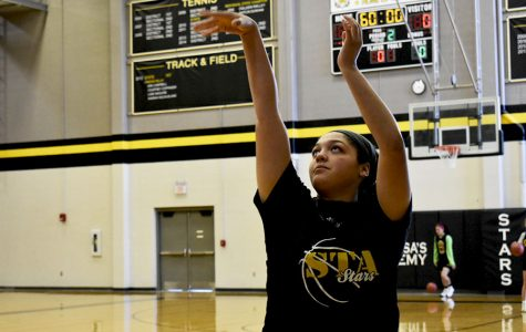 Senior, Hailey Coleman, shoots the first day of basketball tryouts Oct. 30. Coleman is the only senior trying out this season.