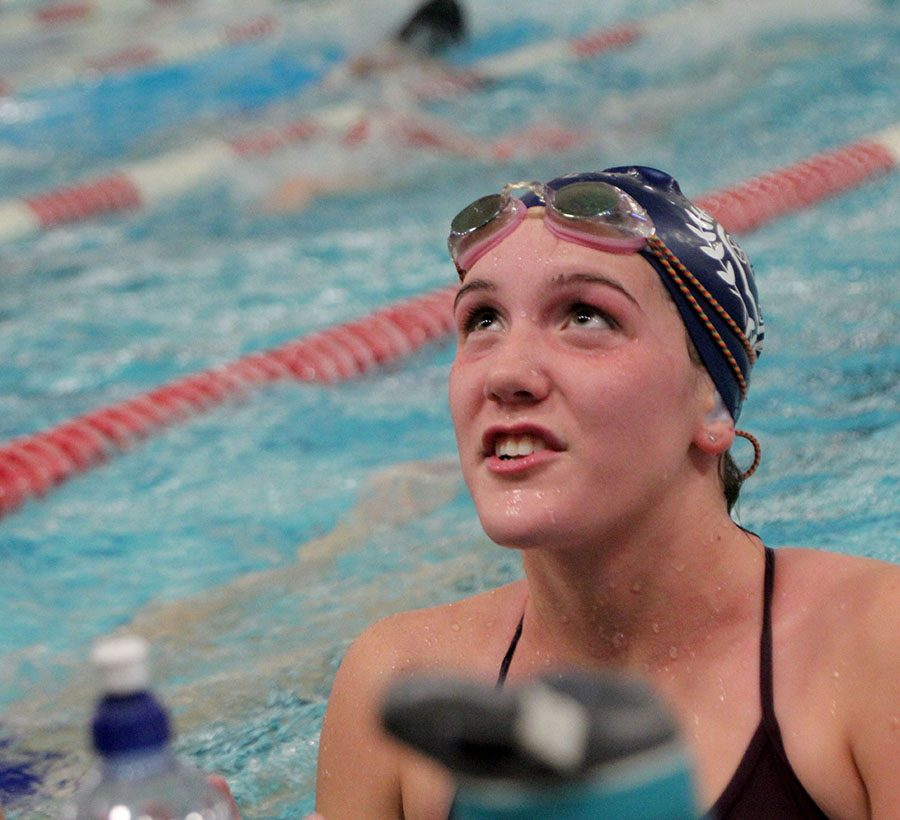 Senior+Maddie+Adam+looks+up+at++coach+Kelly+during+swim+practice+Nov.+14.+Adam+has+been+swimming+for+STA+since+her+freshman+year.+photo+by+Riley+McNett