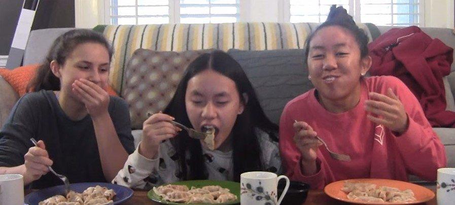 Sophomores Ella Kugler, from left, Elizabeth Frye and Trang Nguyen begin eating dumplings at Kugler's house Nov. 18. The goal was to eat 11 dumplings in one minute.