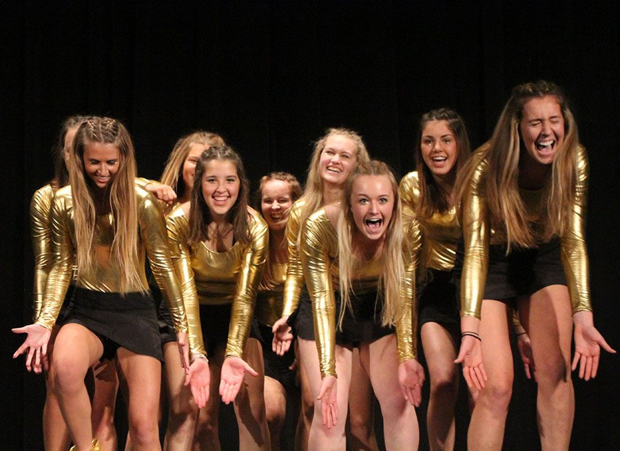 Girls With High Self Esteem dance in a huddle at Senior Airbands Dec.1. Girls With High Self Esteem was the ninth out of ten groups that performed.  photo by Meghan Baker
