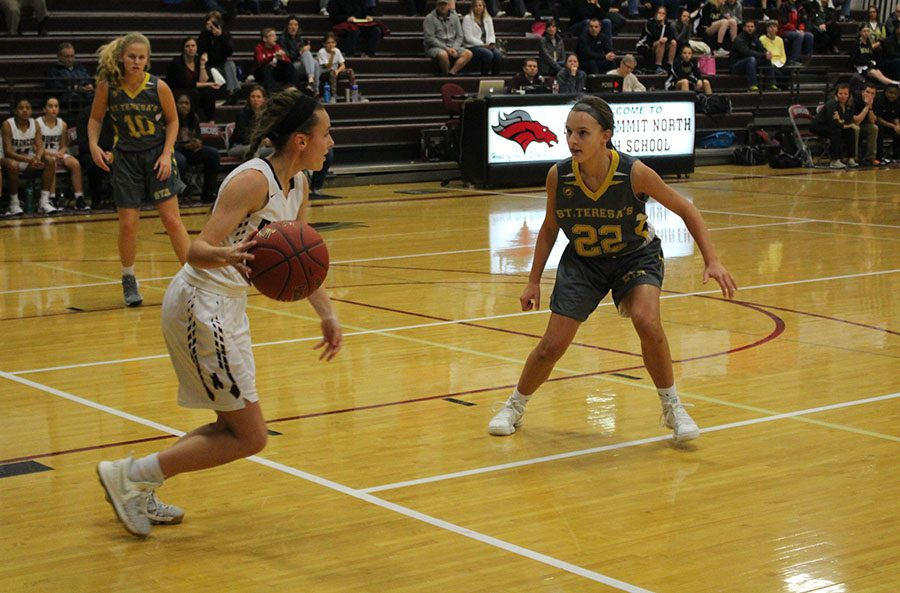 Sophomore+Grace+Kauten+blocks+a+Lee+Summit+North+player+Dec.+4.+Kauten+has+been+involved+with+STA+basketball+for+two+years.+photo+by+Madeline+Loehr