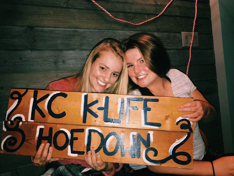 Freshman+Avery+Spooner%2C+left%2C+holds+a+sign+with+K-life+friend+Shawnee+Mission+East+freshman+Meredith+McGannon+at+K-life+Hoedown+Oct.+21.+Spooner+has+gone+to+Kanakuk+since+she+was+6+years+old.+photo+courtesy+of+Avery+Spooner