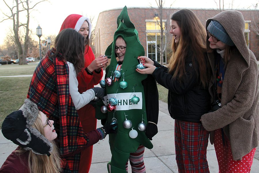Seniors Bridget Graham, from left, Vanessa Eicholz, Kiernan O'Boyle, Claire Molloy and Maura Graham admire Emilie Blanck's, center, Christmas tree costume. The senior class was encouraged to wear Christmas pajamas and costumes to decorate the quad for Christmas Dec. 11. photo by Anna Louise Sih