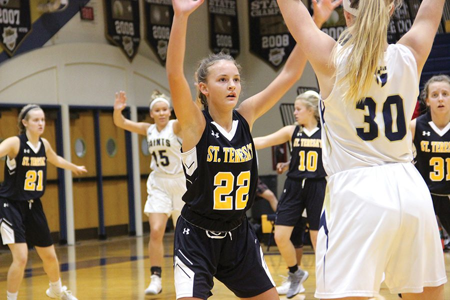 Sophomore Grace Kauten plays defense against a player from Saint Thomas Aquinas High School Jan. 10. Kautan is a member of the varsity basketball team. photo by Anna Louise Sih
