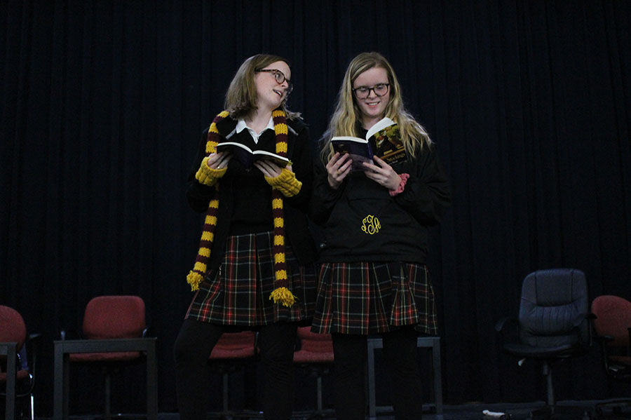 Seniors Maura Graham, left, and Bridget Graham practice lines together before rehearsal Jan. 23. They are playing the same character in the winter play Blue Stockings. photo by Madeline Loehr