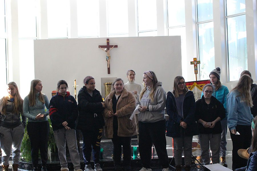 Students going on the March for Life stand in a line after exchanging prayer cards Jan. 17. Girls going on the trip will be flying to Washington, D.C.  photo by Madeline Loehr