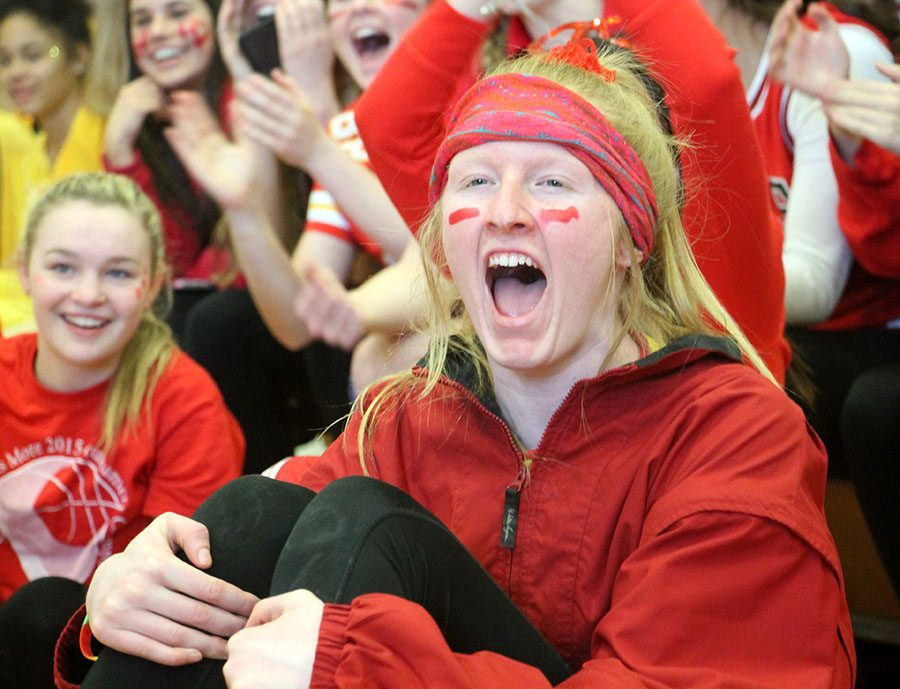 Sophomore Grace Decker cheers for her fellow sophomores at the Fame Games Feb. 16. Sophomores were assigned to wear red to show their spirit. photo by Meghan Baker