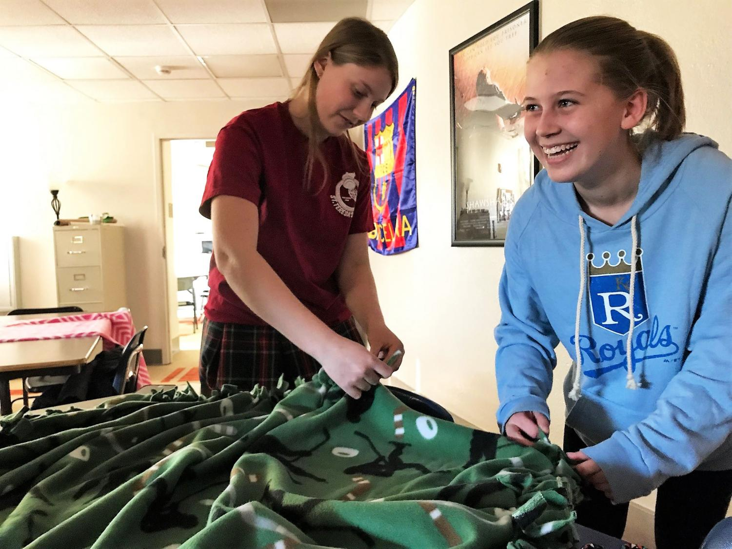 Junior Holy Phalen and senior Megan Warnecke worked together on a blanket during activity Feb. 2. Rotary is an extracurricular dedicated to service. photo by Gabrielle Pesek