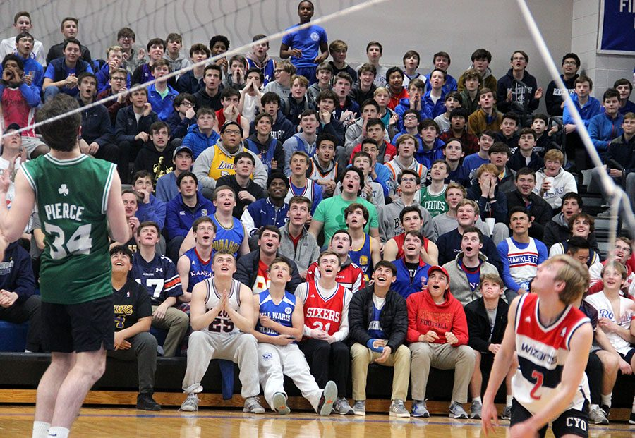 The+Rockhurst+High+School+student+section+looks+up+as+the+volleyball+reaches+its+peak.+Rockhurst+beat+STA+in+the+final+match.+photo+by+Zoe+Butler