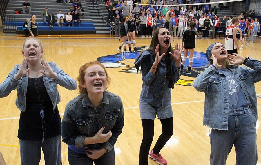 Seniors Mary Kate Armstrong, from left, Hannah Steen, Mia Schloegel and Monica Looney scream a cheer to the student section. These girls are make up the executive officers of spirit club. photo by Zoe Butler
