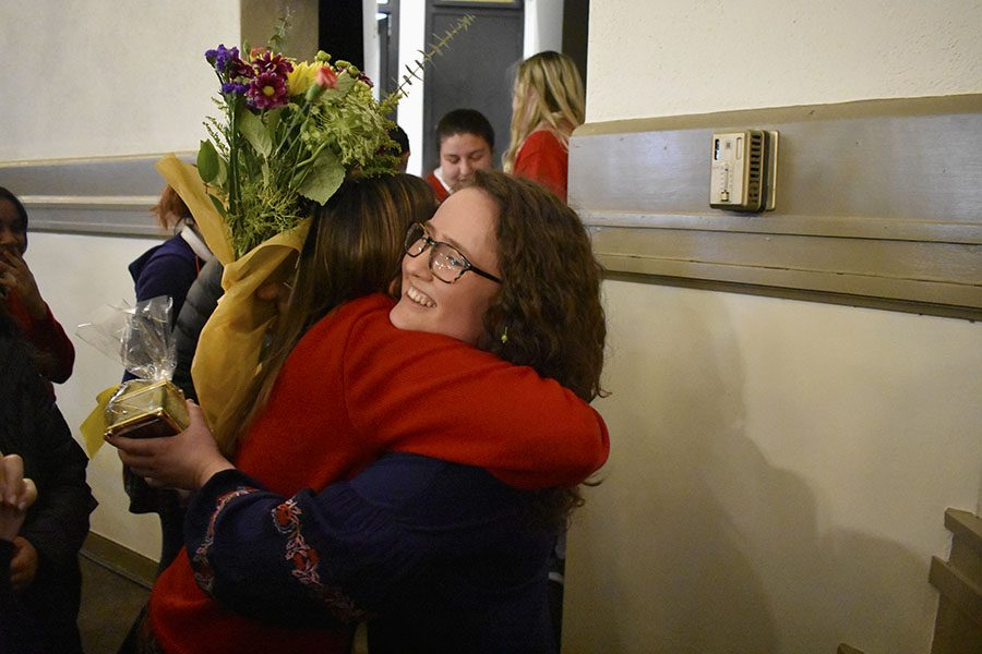 Senior Emilie Blanck hugs her classmate after winning Academy Woman March 8. The Academy Woman ceremony was held in the Auditorium. photo by Grace Fiorella