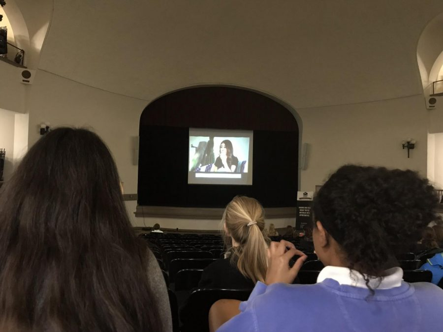 Juniors Natalie Telep, left, and Gabrielle Mesa sit in the auditorium to watch the screening of